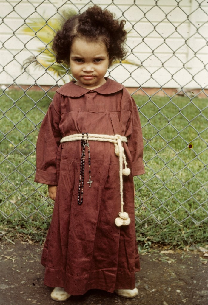"""""""About a promise made, little neighbor in dress of vow to St. Anthony""""<br>Orpha Leatherman - Early 1950s"""